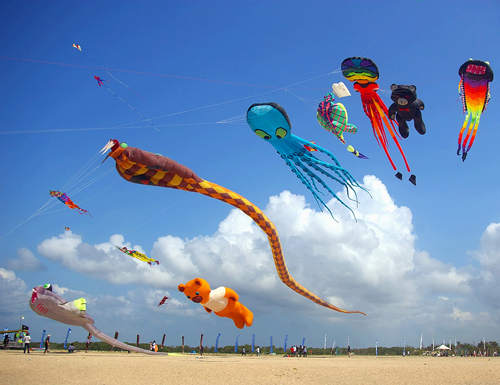 Colourful kites on the beach